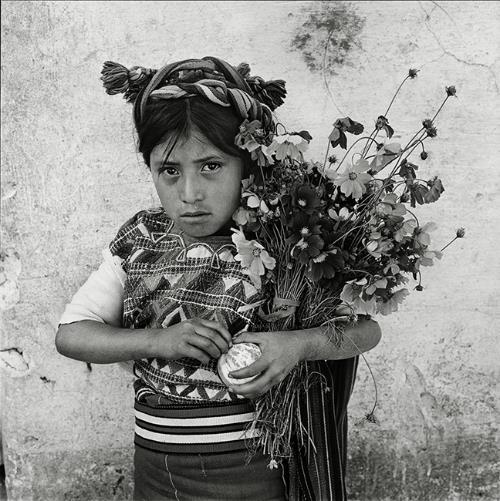 Untitled (Girl with Flowers), Guatemala, 1978 © Rosalind Solomon, www.rosalindsolomon.com. Courtesy of Bruce Silverstein Gallery
