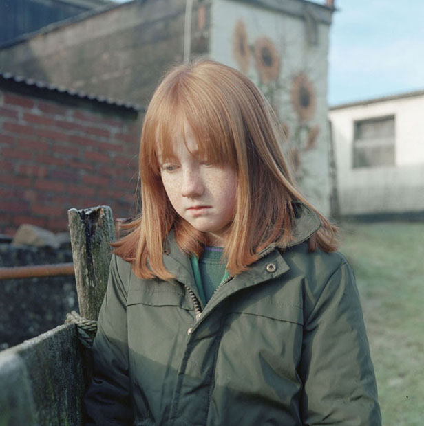 Jenna aged 9, watches chickens feeding at the Cwnoernant farm in Carmarthenshire on the edge of the Landsker line. The Landsker line is an invisible but definite line that has been present for nearly a thousand years and divides the South West corner of Wales from the rest of the country.