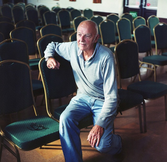Clive Law moved to Pembrokeshire 20 years ago from Reading near London. He was attracted to the natural beauty of the rural landscape. Here he sits at his local village hall in Penally.