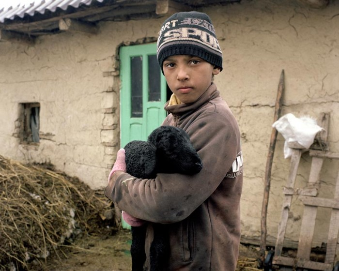 """Paltinis, Romania 2014 Paltinis, a small village in the Vaslui region, is mainly populated by Gypsies. Here Chevron had planned to set up a shale gas well, before officially quit Romania due to """"poor exploration results and prolonged protests by environmentalists""""."""